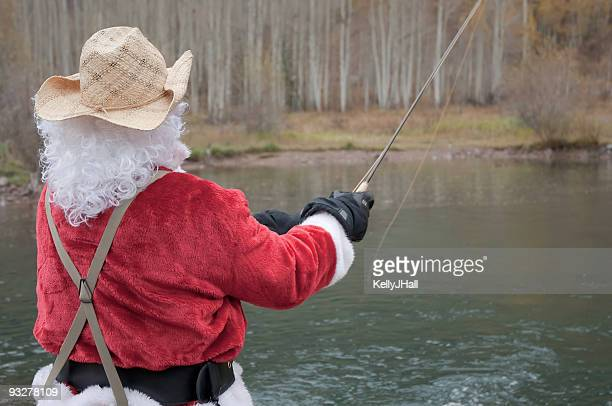 santa claus fly fishing - mere noel stock pictures, royalty-free photos & images