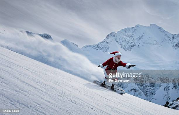Santa Claus flying down a mountain on a snowboard
