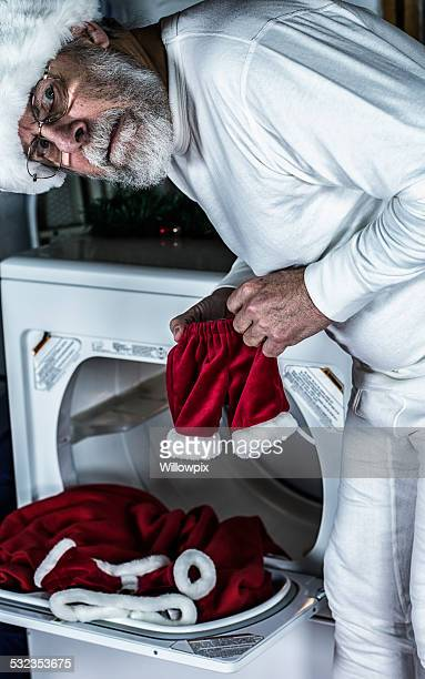 santa claus frustration with shrunken costume pants - man in tight pants stock photos and pictures