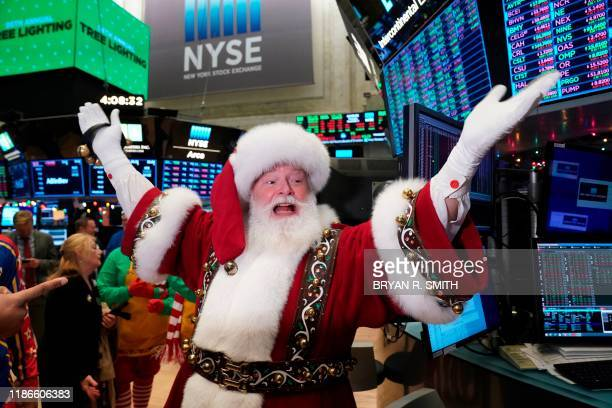 Santa Clause gestures on the floor at the closing bell of the Dow Industrial Average at the New York Stock Exchange on December 5 2019 in New York...
