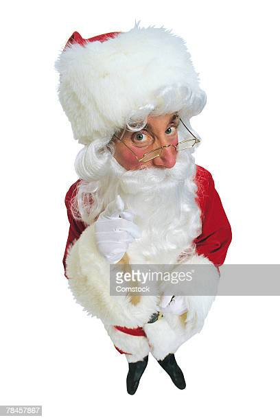 santa claus gesturing do not be naughty - naughty santa stock photos and pictures