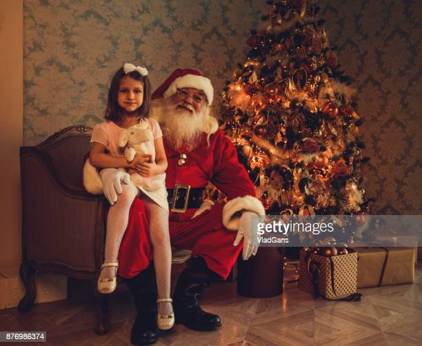 santa claus gives presents - girls open legs stock photos and pictures