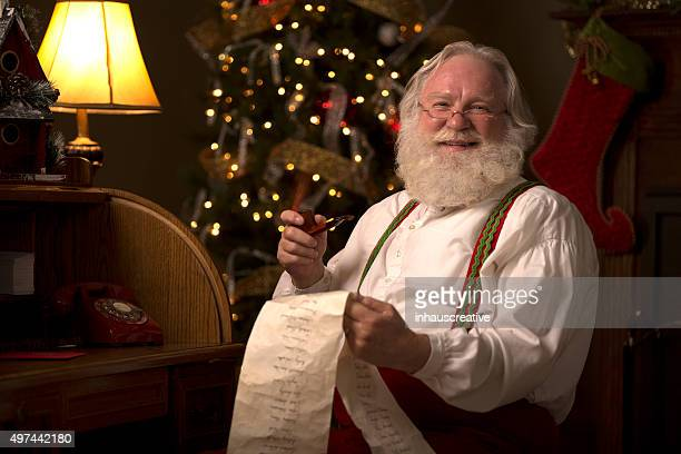 Santa Claus going over his naughty and nice list