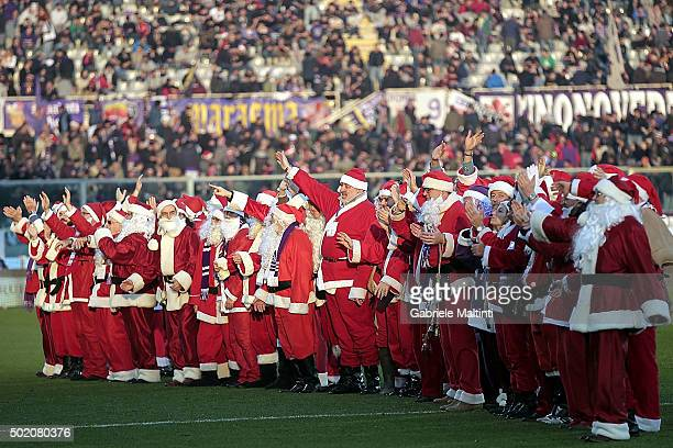 Santa Claus greets fans during the Serie A match between ACF Fiorentina and AC Chievo Verona at Stadio Artemio Franchi on December 20 2015 in...