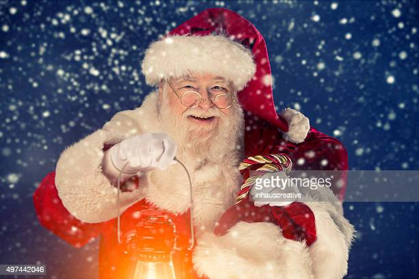 Santa Claus happy that it is snowing
