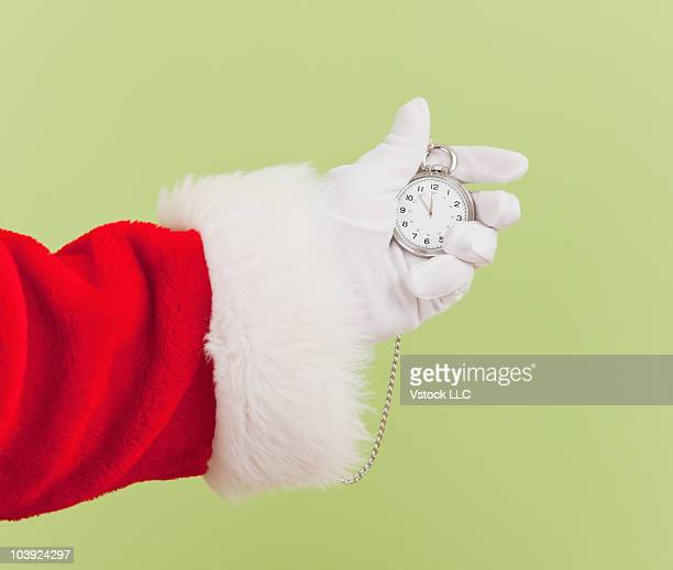 Santa Claus holding a pocket watch