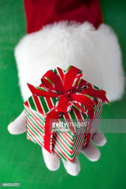 Santa Claus holding Christmas gift