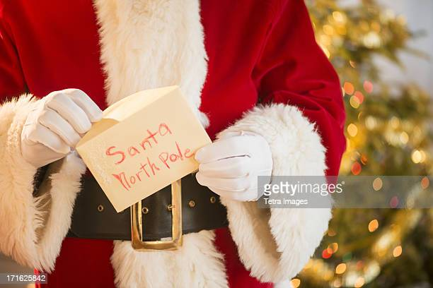 santa claus holding letter - message stock pictures, royalty-free photos & images