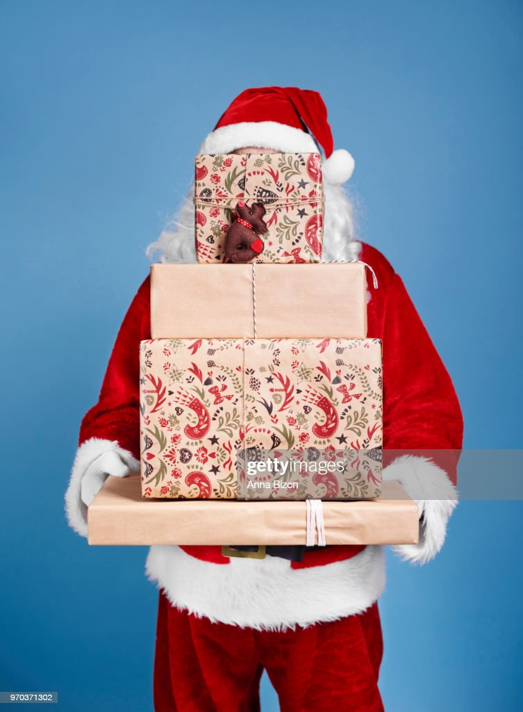 Santa Claus holding stack of christmas gifts. Debica, Poland : Stockfoto