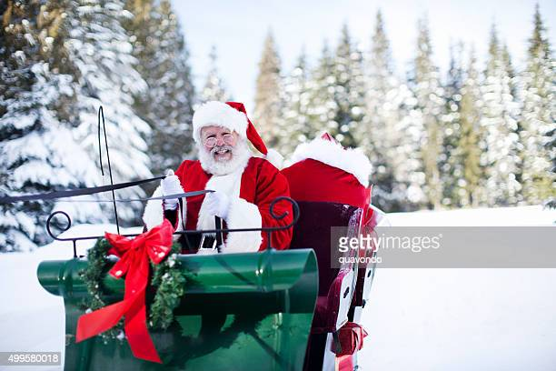 santa claus in his sleigh at north pole - sleigh stock photos and pictures