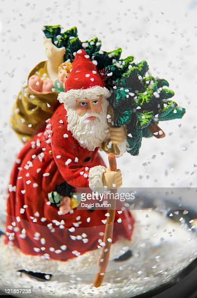 santa claus in novelty glass snow dome