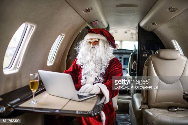 Santa Claus in private jet airplane
