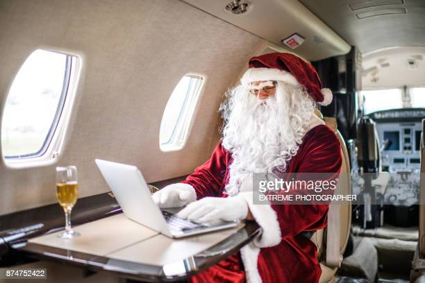 Santa Claus in private jet airplane