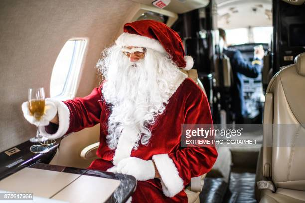 santa claus in private jet airplane - christmas plane stock pictures, royalty-free photos & images