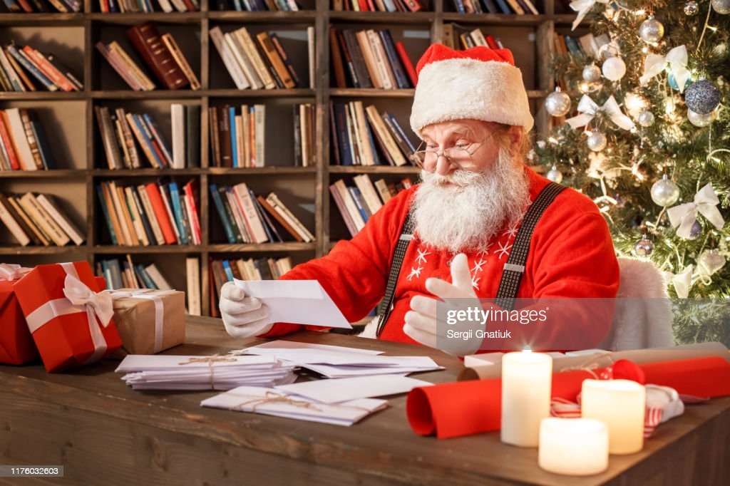 Santa Claus in the library christmas new year concept : Stock Photo