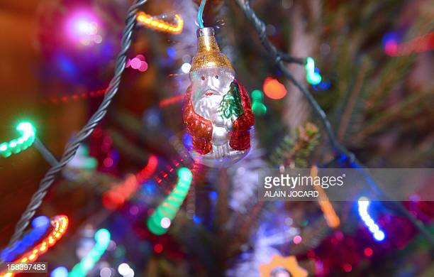 A Santa Claus is hanged on a Christmas tree on December 15 2012 in Chisseaux near Tours AFP PHOTO/ALAIN JOCARD