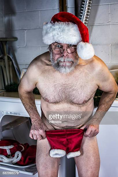 Santa Claus Is Naked and Shocked With Shrunken Costume Pants