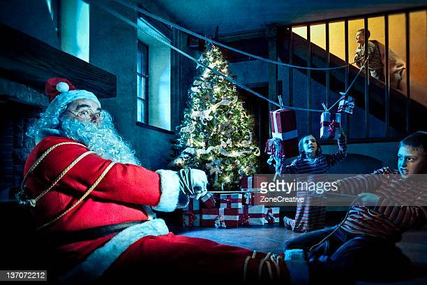 santa claus kidnapped by children's gang - naughty santa stock photos and pictures