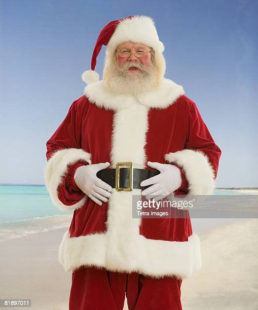 Santa Claus laughing at beach