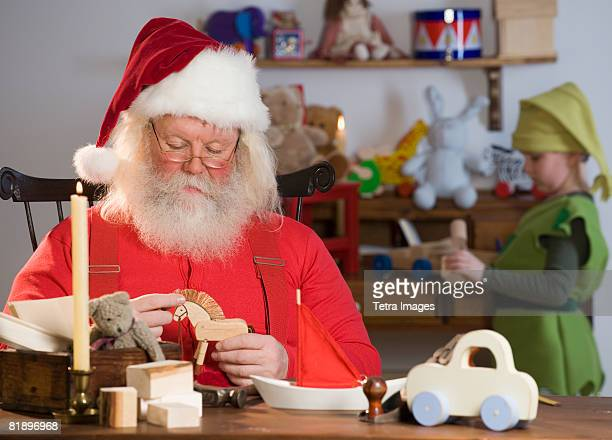 Santa Claus looking at toys