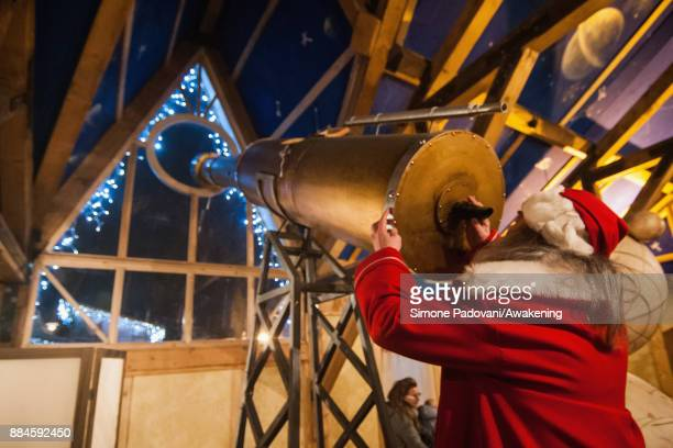 Santa Claus looks at the periscope in his house in the Reggia of Venaria on December 2 2017 in Turin Italy