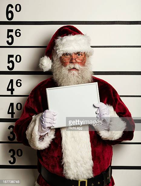 santa claus mugshot - negative emotion stock pictures, royalty-free photos & images