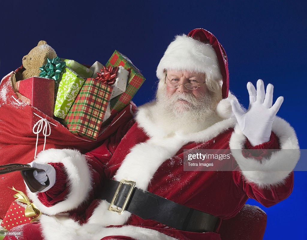 Santa Claus next to bag of toys : Foto de stock