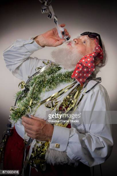 Santa Claus on a party blowing streamers