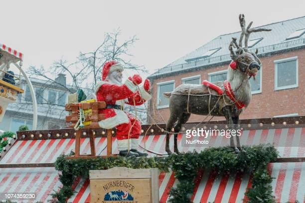 Santa Claus on a sled with a reindeer The worldfamous Christmas Market of Nuremberg was full of people even if there was heavy snowfall and cold