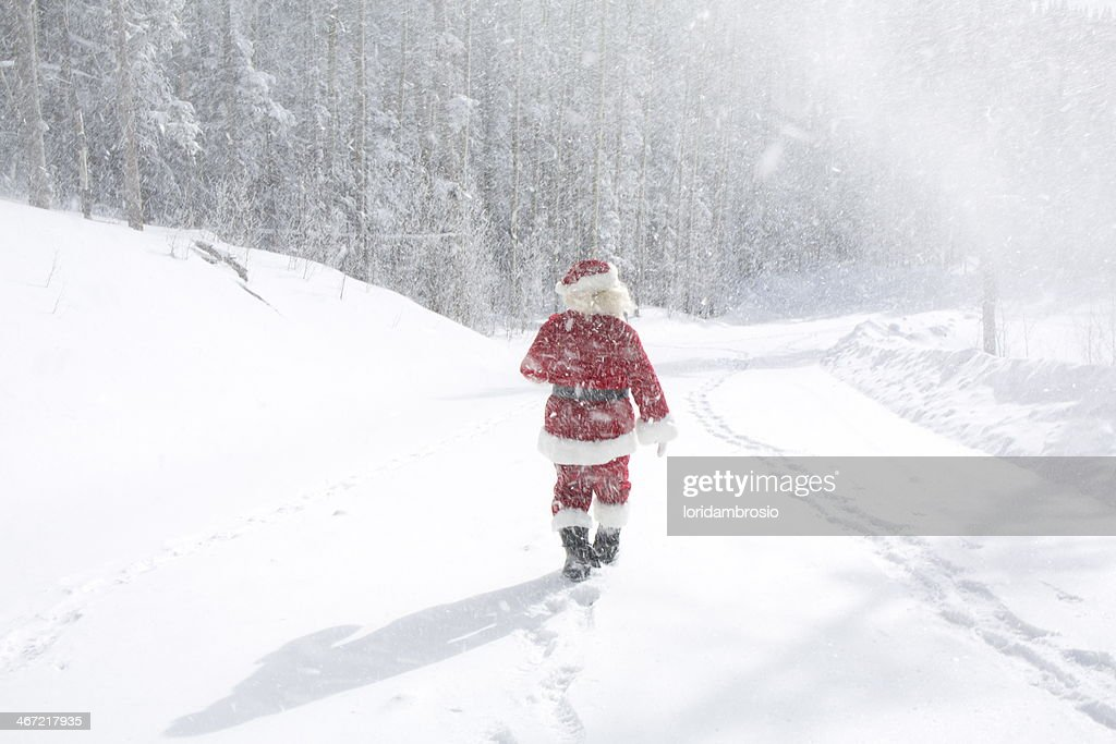 Santa Claus on a snowy roadway : Stock Photo