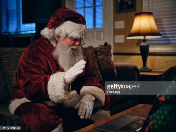 santa claus on a video conference call - father christmas stock pictures, royalty-free photos & images
