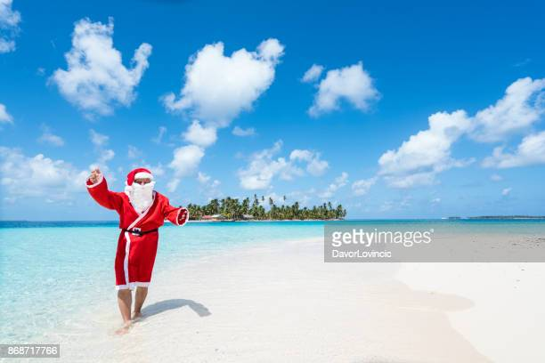 santa claus on beach  of isla de perro island in caribbean see, panama - caribbean christmas stock pictures, royalty-free photos & images