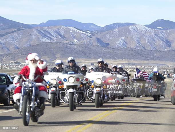 Santa Claus on his harley leads a pack of riders in the Rocky Mountain Harley Davison 15th annual Toy Run to Childrens Hospital which included local...