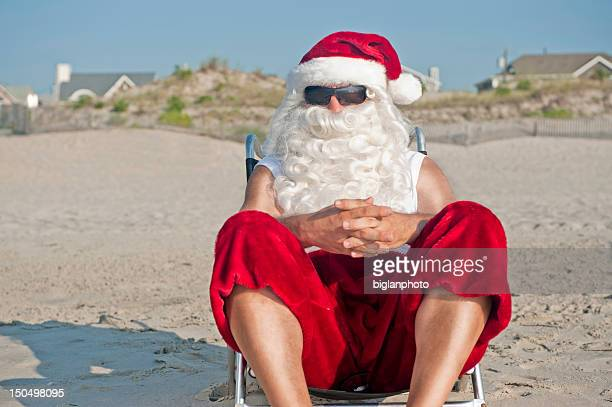 santa claus on vacation - july stock pictures, royalty-free photos & images