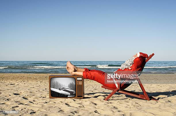 Santa Claus On Vacation, Sunbathing On The Beach