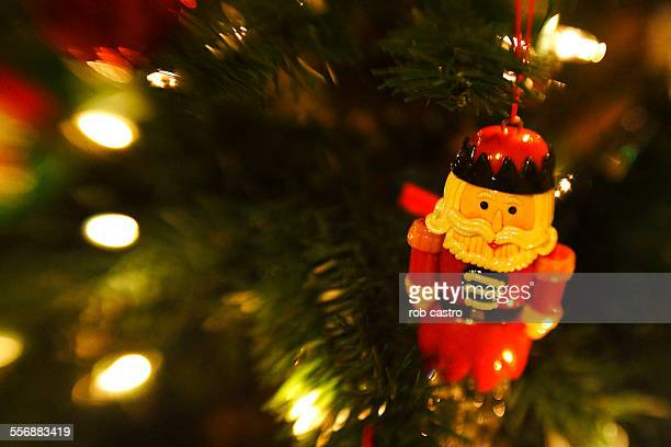 santa claus ornament on christmas tree - rob castro stock pictures, royalty-free photos & images