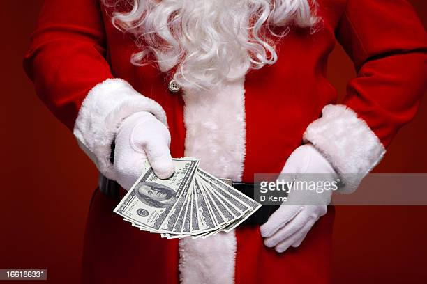 santa claus - christmas cash stock pictures, royalty-free photos & images