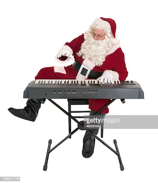 Santa Claus Playing a Keyboard with a White Background