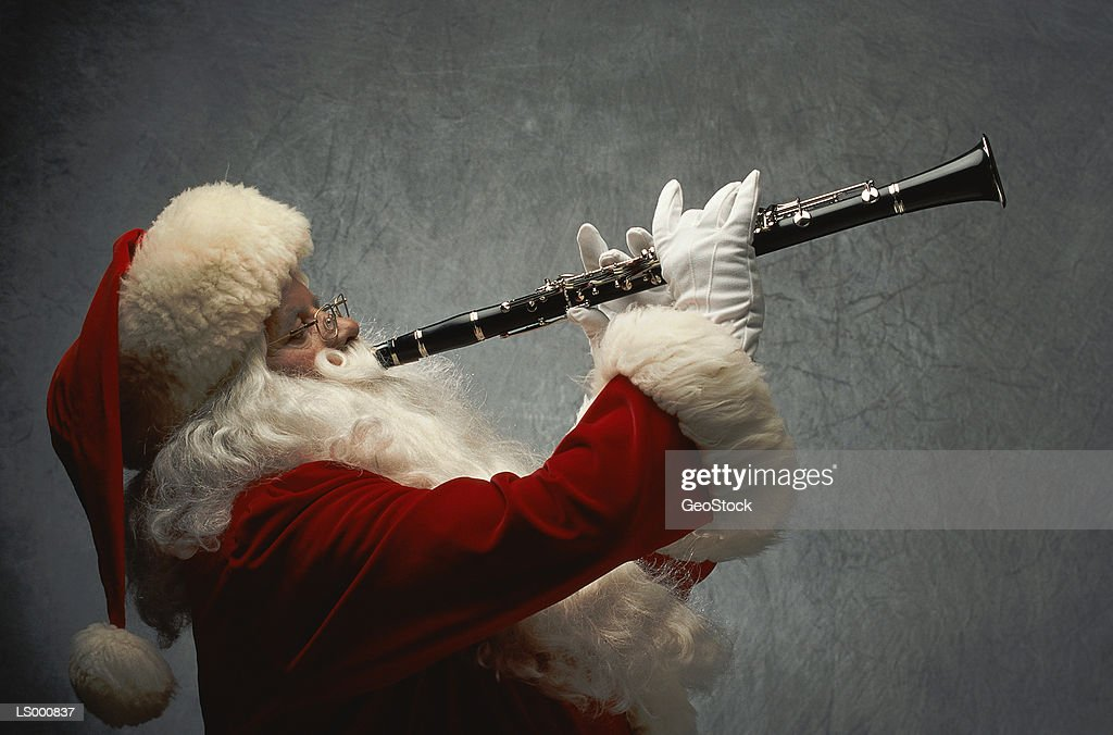 Santa Claus Playing Clarinet : Stock Photo
