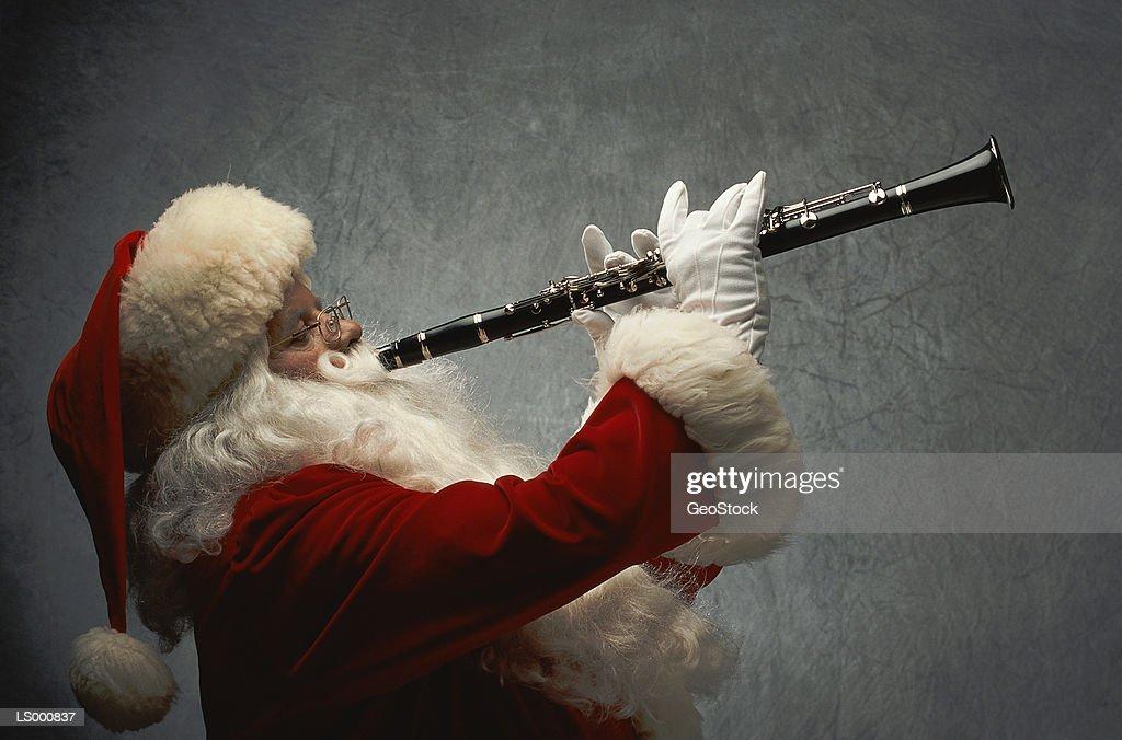 Santa Claus Playing Clarinet : Stock Photo