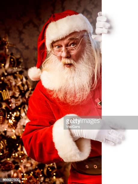 santa claus pointing on blank banner - santa stock photos and pictures