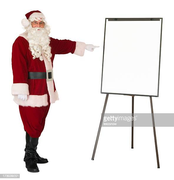 Santa Claus pointing to an isolated whiteboard
