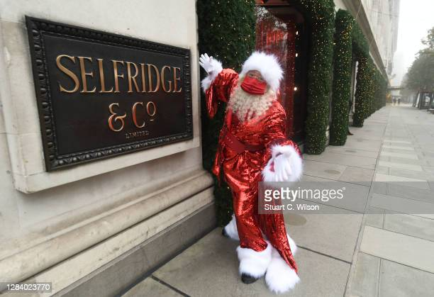 Santa Claus poses outside Selfridges, Oxford Street during the Christmas window display unveiling on November 05, 2020 in London, England.