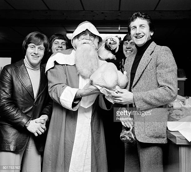 Santa Claus presenting Derby County footballers including Roy McFarland with their Christmas turkeys on 23rd December 1976