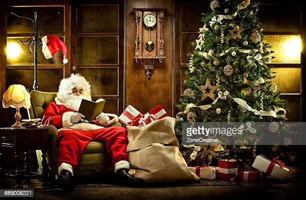 Santa Claus read book in a vintage house