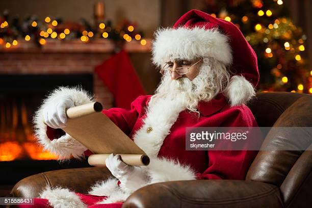Santa Claus reading a list.