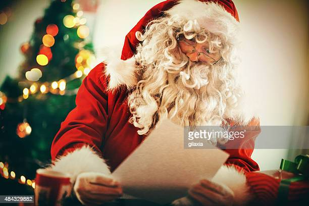 Santa Claus reading letters and wishlists.