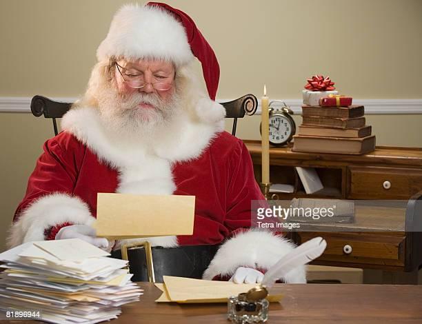 Santa Claus reading mail