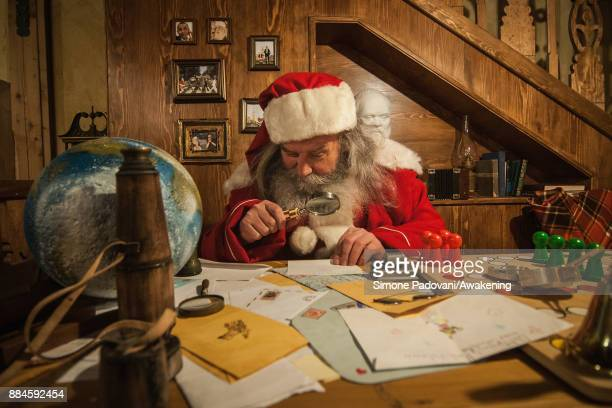 Santa Claus reads a letter in his house in the Reggia of Venaria on December 2 2017 in Turin Italy