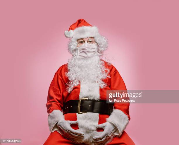 santa claus ready for covid-19 - father christmas stock pictures, royalty-free photos & images